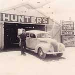 Hector Hunter outside Hunter's Garage, Hughenden; 1940s; Object 2011-62; From the Flinders Shire Historical Photographic Project